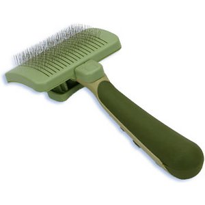 The Safari Slicker Brush for Border Collies with a self-cleaning feature
